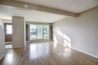 Photo 8: 321 FALSHIRE Drive NE in Calgary: Falconridge Detached for sale : MLS®# C4301765