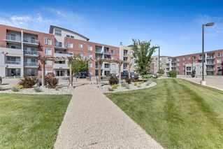 Photo 1: 1218 604 East Lake Boulevard NE: Airdrie Apartment for sale : MLS®# A1023552
