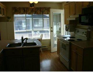 Photo 3: 9 2450 LOBB AV in Port_Coquitlam: House for sale (Canada)  : MLS®# V608765