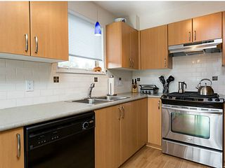Photo 2: # 310 200 KLAHANIE DR in Port Moody: Port Moody Centre Condo for sale : MLS®# V1049351