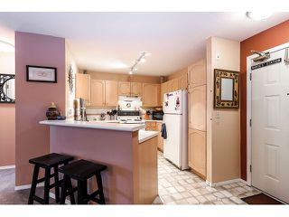 Photo 2: # 101 10756 138TH ST in Surrey: Whalley Condo for sale (North Surrey)  : MLS®# F1444754