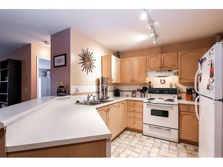 Photo 3: # 101 10756 138TH ST in Surrey: Whalley Condo for sale (North Surrey)  : MLS®# F1444754