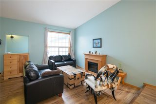 Photo 4: 16 WELLINGTON Cove: Strathmore Row/Townhouse for sale : MLS®# C4258417
