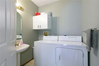 Photo 13: 16 WELLINGTON Cove: Strathmore Row/Townhouse for sale : MLS®# C4258417
