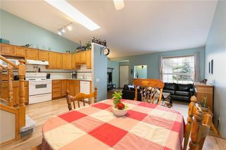 Photo 5: 16 WELLINGTON Cove: Strathmore Row/Townhouse for sale : MLS®# C4258417