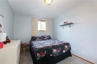 Photo 16: 16 WELLINGTON Cove: Strathmore Row/Townhouse for sale : MLS®# C4258417