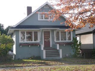Photo 1: 1564 West 66th Avenue in Vancouver: Home for sale