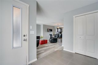 Photo 3: 254 WALDEN Gate SE in Calgary: Walden Row/Townhouse for sale : MLS®# C4305539