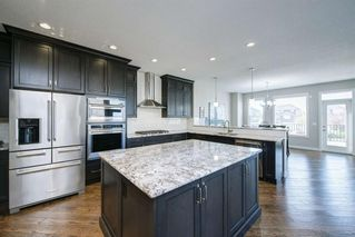 Photo 4: 257 BOULDER CREEK Crescent: Langdon Detached for sale : MLS®# A1016379