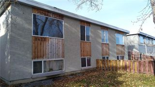 Main Photo: 2423 48 Street SE in Calgary: Forest Lawn Row/Townhouse for sale : MLS®# A1059732