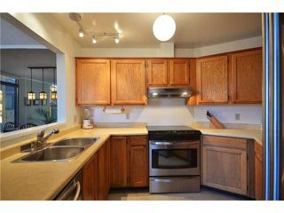 """Photo 4: 13 1201 LAMEY'S MILL Road in Vancouver: False Creek Condo for sale in """"ALDER BAY PLACE"""" (Vancouver West)  : MLS®# V930096"""