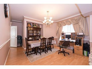 Photo 4: 12321 91A Avenue in Surrey: Queen Mary Park Surrey House for sale : MLS®# F1410080