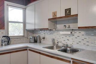 Photo 11: 307 26 Avenue NE in Calgary: Tuxedo Park Detached for sale : MLS®# A1039987