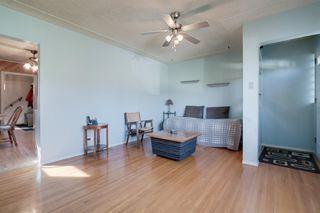Photo 8: 307 26 Avenue NE in Calgary: Tuxedo Park Detached for sale : MLS®# A1039987