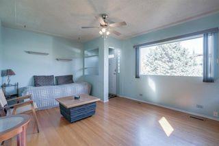 Photo 5: 307 26 Avenue NE in Calgary: Tuxedo Park Detached for sale : MLS®# A1039987
