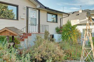 Photo 2: 307 26 Avenue NE in Calgary: Tuxedo Park Detached for sale : MLS®# A1039987