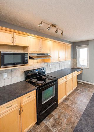 Photo 13: 127 Morningside Manor SW: Airdrie Detached for sale : MLS®# A1048913