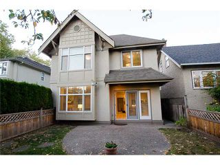 Photo 1: 2871 W 16TH Avenue in Vancouver: Kitsilano House 1/2 Duplex for sale (Vancouver West)  : MLS®# V975217
