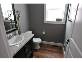Photo 6: 7125 177A ST in Surrey: Cloverdale BC House for sale (Cloverdale)  : MLS®# F1419223