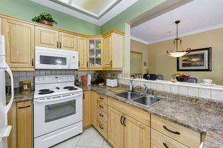 """Photo 4: 424 2995 PRINCESS Crescent in Coquitlam: Canyon Springs Condo for sale in """"Princess Gate"""" : MLS®# R2395746"""