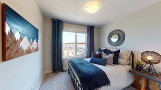 Photo 5: 105 Crestridge Common SW in Calgary: Crestmont Row/Townhouse for sale : MLS®# A1052783