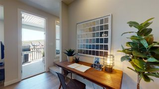 Photo 4: 105 Crestridge Common SW in Calgary: Crestmont Row/Townhouse for sale : MLS®# A1052783