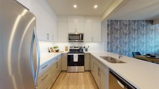 Photo 3: 105 Crestridge Common SW in Calgary: Crestmont Row/Townhouse for sale : MLS®# A1052783