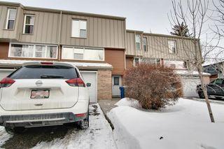 Main Photo: 99 Brae Glen Lane SW in Calgary: Braeside Row/Townhouse for sale : MLS®# A1057848