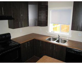 Photo 2: 501 2445 KINGSLAND Road SE: Airdrie Townhouse for sale : MLS®# C3391132