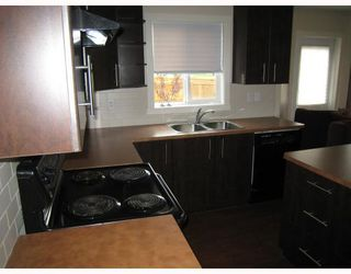 Photo 3: 501 2445 KINGSLAND Road SE: Airdrie Townhouse for sale : MLS®# C3391132