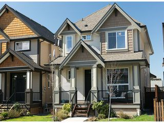 """Photo 1: 7317 194A Street in Surrey: Clayton House for sale in """"Clayton Village"""" (Cloverdale)  : MLS®# F1311061"""