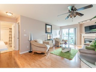 """Photo 3: 205 20277 53 Avenue in Langley: Langley City Condo for sale in """"Metro II"""" : MLS®# R2388554"""