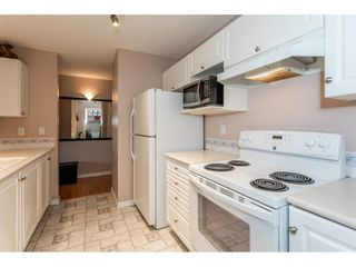 """Photo 8: 205 20277 53 Avenue in Langley: Langley City Condo for sale in """"Metro II"""" : MLS®# R2388554"""