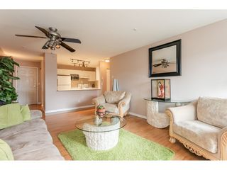"""Photo 4: 205 20277 53 Avenue in Langley: Langley City Condo for sale in """"Metro II"""" : MLS®# R2388554"""