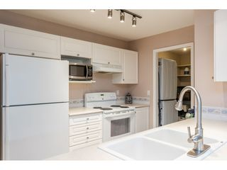 """Photo 6: 205 20277 53 Avenue in Langley: Langley City Condo for sale in """"Metro II"""" : MLS®# R2388554"""