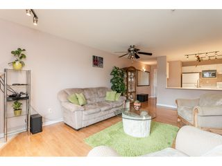 """Photo 5: 205 20277 53 Avenue in Langley: Langley City Condo for sale in """"Metro II"""" : MLS®# R2388554"""