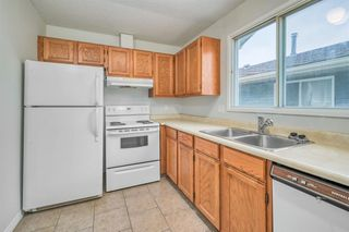 Photo 9: 35 SANDSTONE Drive NW in Calgary: Sandstone Valley Detached for sale : MLS®# A1031986