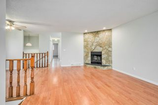Photo 6: 35 SANDSTONE Drive NW in Calgary: Sandstone Valley Detached for sale : MLS®# A1031986