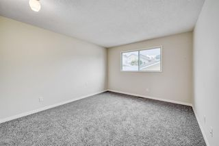 Photo 15: 35 SANDSTONE Drive NW in Calgary: Sandstone Valley Detached for sale : MLS®# A1031986
