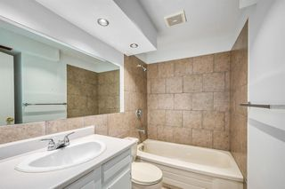 Photo 11: 35 SANDSTONE Drive NW in Calgary: Sandstone Valley Detached for sale : MLS®# A1031986