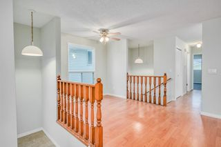 Photo 4: 35 SANDSTONE Drive NW in Calgary: Sandstone Valley Detached for sale : MLS®# A1031986