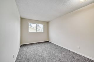 Photo 12: 35 SANDSTONE Drive NW in Calgary: Sandstone Valley Detached for sale : MLS®# A1031986