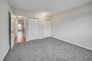 Photo 13: 35 SANDSTONE Drive NW in Calgary: Sandstone Valley Detached for sale : MLS®# A1031986
