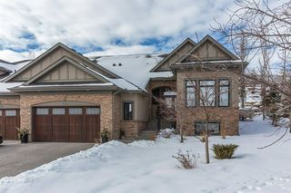 Main Photo: 33 ELMONT View SW in Calgary: Springbank Hill Semi Detached for sale : MLS®# A1061574