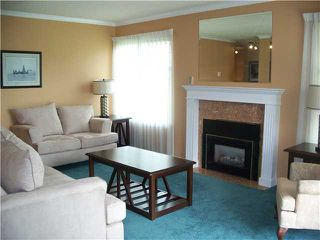 "Photo 3: 108 22514 116TH Avenue in Maple Ridge: East Central Condo for sale in ""FRASER COURT"" : MLS®# V965506"