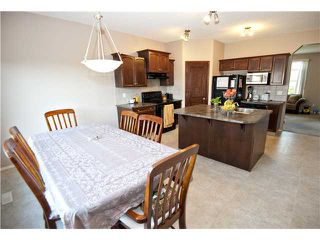 Photo 7: 98 COVEHAVEN Mews NE in CALGARY: Coventry Hills Residential Attached for sale (Calgary)  : MLS®# C3625840