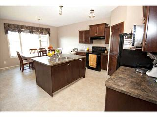 Photo 6: 98 COVEHAVEN Mews NE in CALGARY: Coventry Hills Residential Attached for sale (Calgary)  : MLS®# C3625840