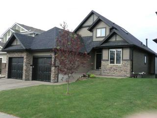 Photo 1: 43 WEST POINTE Manor: Cochrane Residential Detached Single Family for sale : MLS®# C3555764