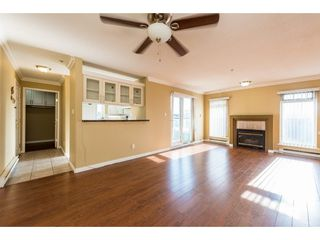 Photo 1: 202 4893 CLARENDON STREET in Vancouver: Collingwood VE Condo for sale (Vancouver East)  : MLS®# R2309205