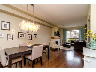 "Photo 1: 94 100 KLAHANIE Drive in Port Moody: Port Moody Centre Townhouse for sale in ""INDIGO AT KLAHANIE"" : MLS®# V998964"